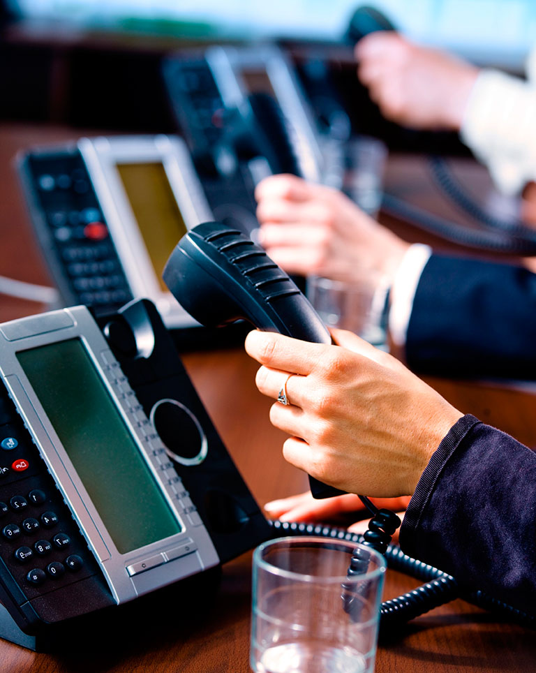 Businesspeople on TRI-TEC phones